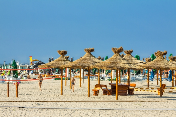 Black Sea coast beach on a sunny day on August 05, 2011 in Mamaia, Romania shutterstock_136267046