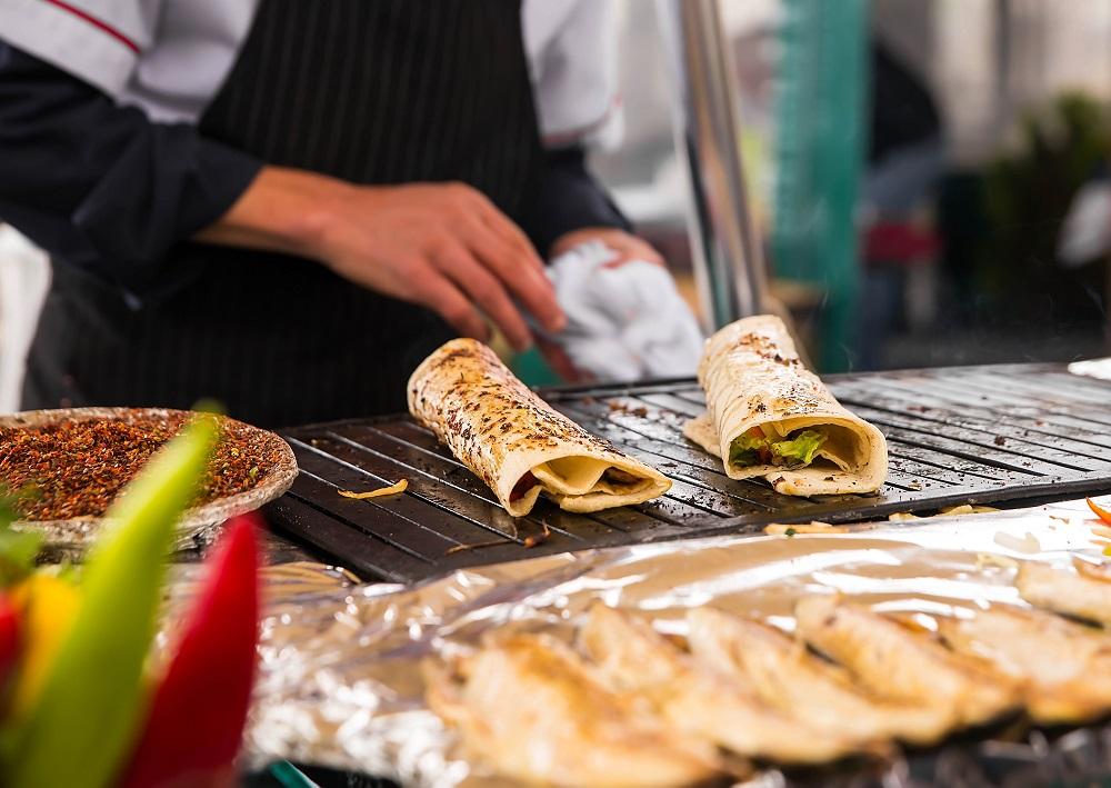 Cooking salmon kebab Turkish bazaar in Istanbul shutterstock
